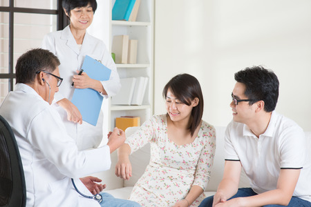Asian couple consult doctor. Woman health concept.