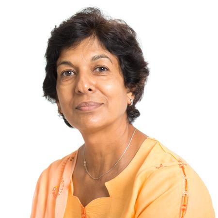 Photo pour Portrait of a 50s Indian mature woman smiling, isolated on white background. - image libre de droit