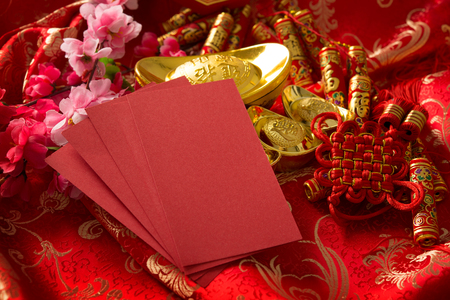 Chinese new year festival decorations, blank ang pow or red packet with copy space ready for text.