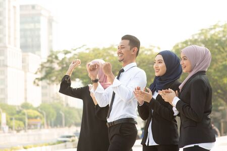 Photo for Group of Muslim business people cheering outdoor. - Royalty Free Image