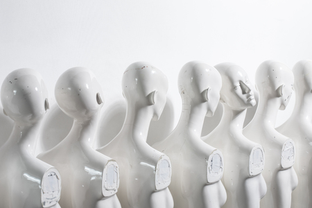 Bright Photography of Plastic Woman Mannequins Standing in The Line, With One Looking to Another Direction then the Others