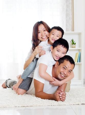 Foto de Asian family having piggyback fun - Imagen libre de derechos