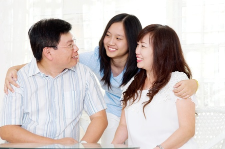 asian middle aged couple and their daughter