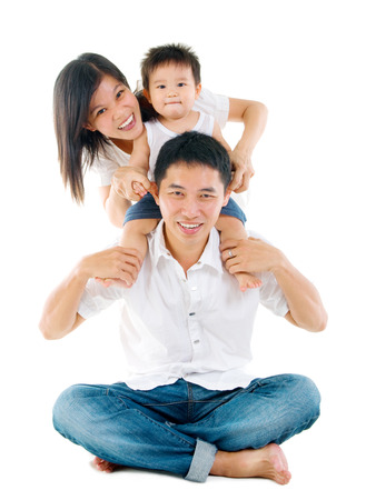 Parents having piggyback fun with their lovely son
