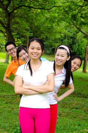 Young asian adults in sports outfit