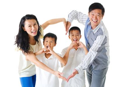 Photo pour Asian family making heart shape with hands - image libre de droit