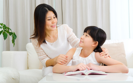 Photo for Asian mother talking to her daughter - Royalty Free Image