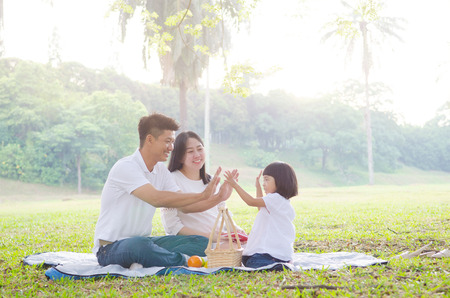Photo for Asian family enjoying outdoor nature - Royalty Free Image
