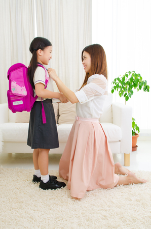 Photo for Asian mother get her daughter ready to school - Royalty Free Image