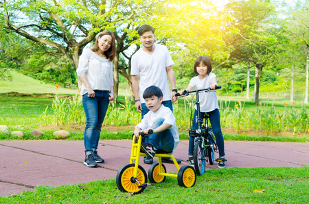 Photo for Asian kids enjoyed cycling at the park - Royalty Free Image