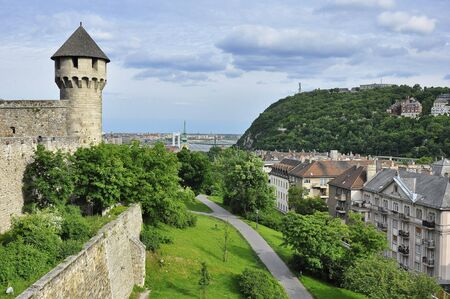 Budapest, Hungary - May 15, 2016: Northern view of the Gellert Hill from the Castle hill, with the Mace Tower (Buzogany Torony) and the Southern Rondella in the foreground