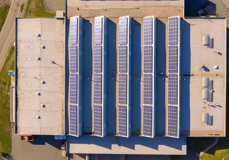 Photo for Top view of a roof of a factory building with solar panel or photovoltaic plant - Royalty Free Image