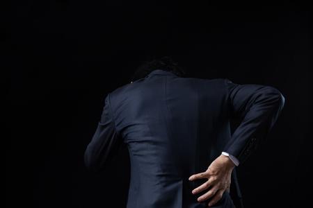 Businessman feeling lower back pain