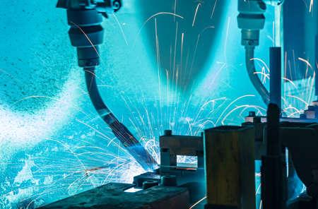 Photo pour Team welding robots represent the movement in the automotive parts industry - image libre de droit