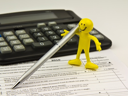 Little Yellow Figure, silver pen, calculator, blank IRS 1040 Form
