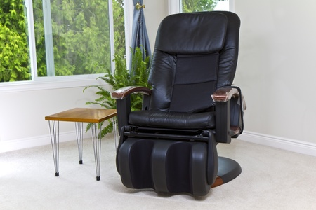 Massage chair in house with windows open