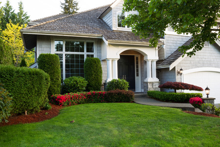 Beautiful home exterior during late spring season with clean landscape