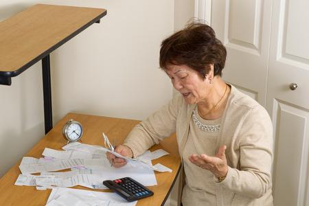 Photo pour Senior woman upset at her bills. In debt concept. - image libre de droit