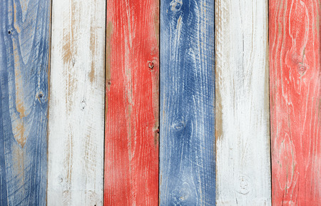 Photo for Stressed wooden boards painted red, white and blue for patriotic concept of United States of America. Layout in vertical format. - Royalty Free Image
