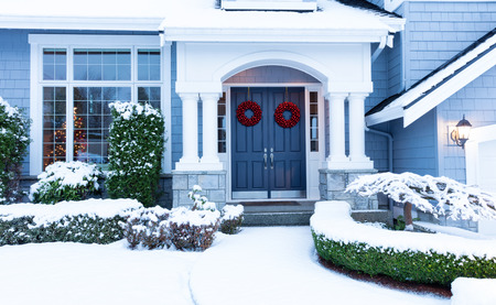 Photo for Walkway to a fresh blanket of snow on residential home during the winter holidays. - Royalty Free Image
