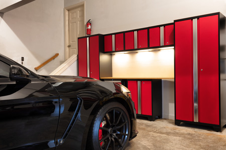 Residential home garage interior highly organized and clean with car inside