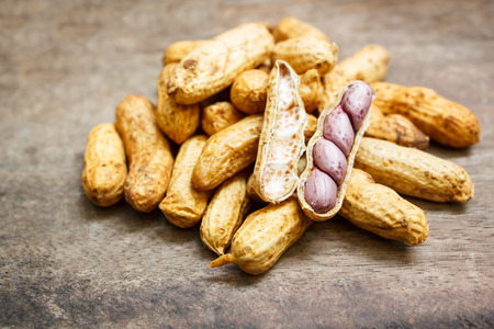 boiled peanuts in shells on wood background.