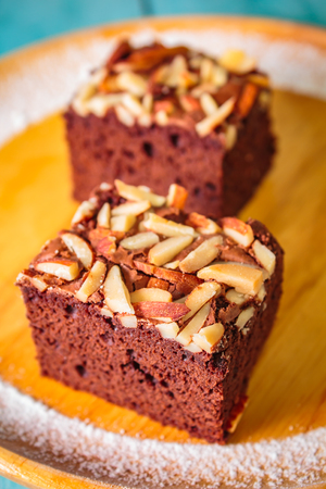 Photo for Homemade brownie cake decorated with almond and chocolate. - Royalty Free Image