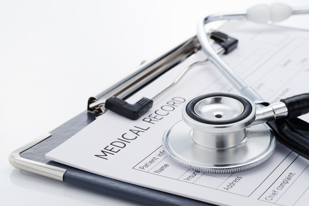 Medical record and stethoscope on white background. Medical examination report. Concept image of the result of a medical...