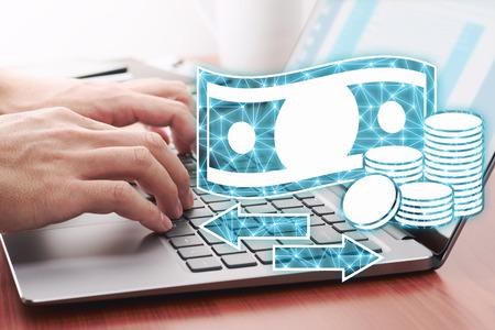 Foto de Online money transfer concept. Using laptop for internet payment. Laptop and money icons. - Imagen libre de derechos