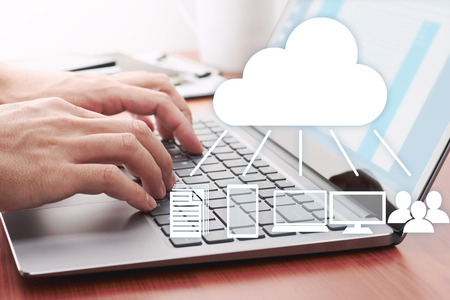 Foto de Cloud computing concept. Sharing data on server. Using laptop for sending data on cloud server. - Imagen libre de derechos