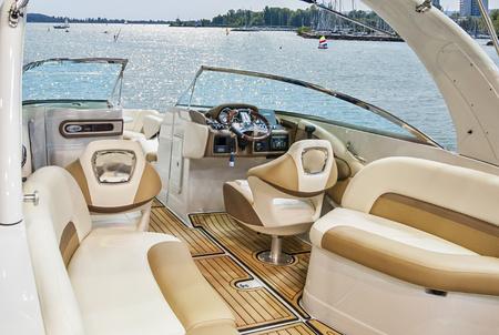 Foto de  Wooden and leather Interior of luxury yacht. Cockpit of yacht at sea - Imagen libre de derechos