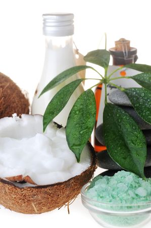 Coconut,salt,stones and massage oil for body close up