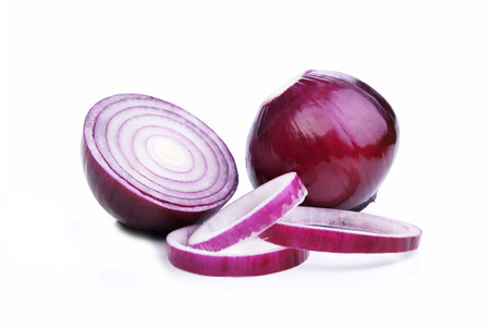 sliced red onions on  white background