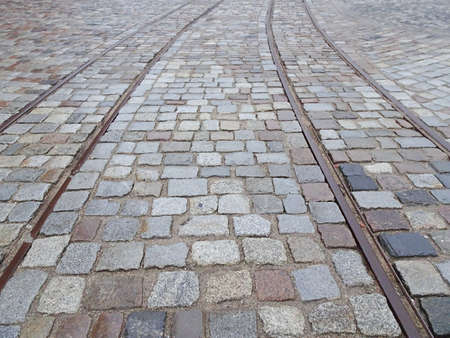 Photo for Old tram rails on paving stones converging towards the horizon, selective focus. High quality photo - Royalty Free Image