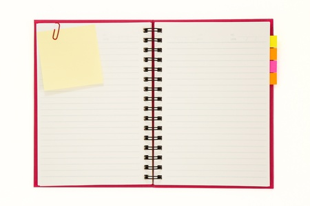 Photo pour Red notebook isolated on white background - image libre de droit