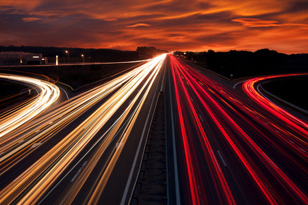Foto de Speed Traffic - light trails on motorway highway at night,  long exposure abstract urban background - Imagen libre de derechos