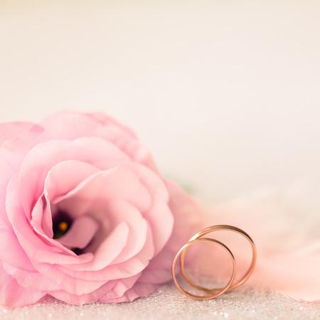 Foto de Vintage Sile Wedding Background with Gold Rings and Beautiful Flower - Imagen libre de derechos