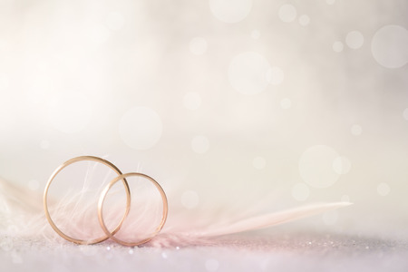 Foto für Two Golden Wedding Rings and  Feather - light soft background for marriage - Lizenzfreies Bild