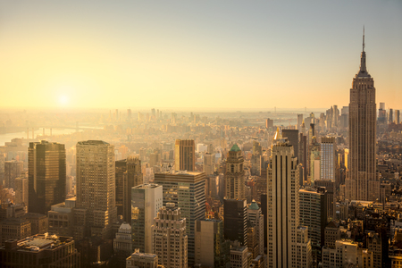 New York City skyline with urban skyscrapers at gentle sunrise, famous Manhattan view, USA