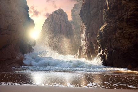 Fantastic big rocks and ocean waves at sundown time.  Dramatic scene. Beauty world landscape.