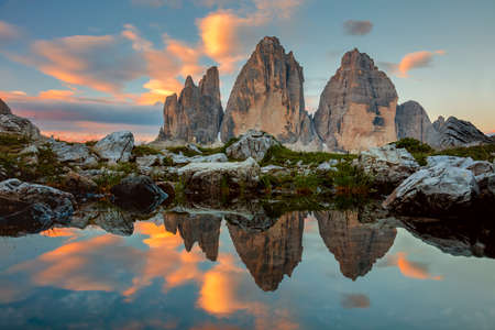 Foto de Tre Cime di Lavaredo at beautiful sunrise with reflection in small lake,  Dolomites, Alps, Italy, Europe (Drei Zinnen) - Imagen libre de derechos