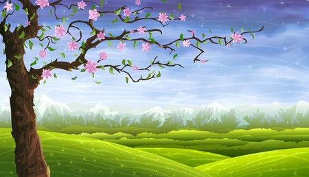 Foto de Blooming fairy-tale tree in front of a colorful rolling landscape - Imagen libre de derechos