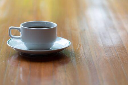 Photo pour Close up a cup of hot  coffee on wooden table. - image libre de droit