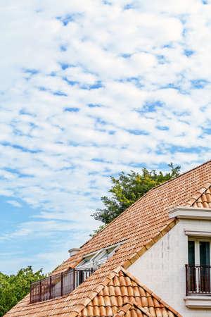 Photo pour Cotton clouds and Western-style houses - image libre de droit