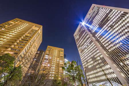 Photo pour High-rise buildings at night - image libre de droit