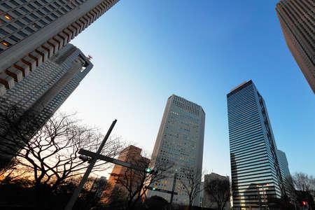 Photo pour High-rise buildings at dusk - image libre de droit