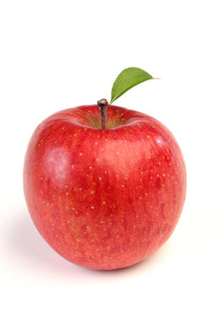 Photo for ripe red apple with a green leaf isolated on white background - Royalty Free Image
