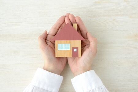 Photo for A house model wrapped in a hand - Royalty Free Image