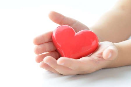 Photo for Children's hands with heart objects - Royalty Free Image