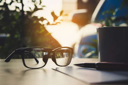 Photo for notebook, glasses, pen and cup of coffee on wooden background. - Royalty Free Image